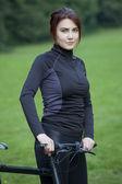 Fitness woman with bike — Foto de Stock