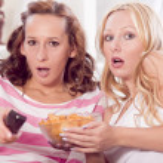 Two women watching horror movie — Stock Photo #6032494
