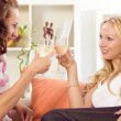 Two women celebrating at home — Stock Photo #6032509