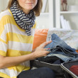 Woman packing her luggage — Stock Photo