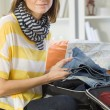 Woman packing her luggage — Stock Photo #6139954