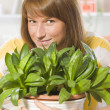 Happy woman with plants — Stock Photo #6139981