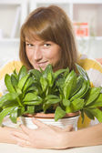 Happy woman with plants — Stock Photo
