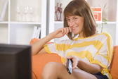 Happy woman watching television — Stock Photo