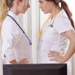 Conflict between two women doctors — Stock Photo