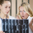 Royalty-Free Stock Photo: Women doctors reading x-ray scans