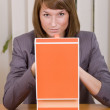 Thinking businesswoman with file card holder — Stock Photo #6283073