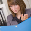 Woman discussing with file — Stock Photo