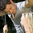 Stock Photo: Romantic couple talking on a swing
