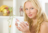 Woman with cup tea at home — Stock Photo