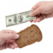 Hands hold the dollar and bread — Stock Photo