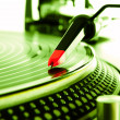 Turntable playing vinyl with music — Stock Photo #5388208