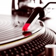 Stock Photo: Turntable playing vinyl with music