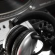 Dynamic headphones laying on mixing controller — Stock Photo #5515752