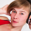 Young girl DJ listening to the music — Stock Photo