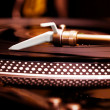 Turntable playing vinyl record — Stock Photo #5554411