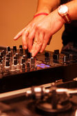 Disc jockey playing music in the club — Stock Photo