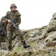 Soldiers moving on mountain with guns — Stock Photo #5607413