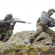 Stock Photo: Soldiers moving on mountain with guns