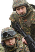 Portrait of two equiped soldiers — Stock Photo