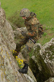 Soldier rappeling — Stock Photo