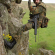 Armed military alpinist hanging on rope - Foto de Stock