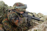 Soldier targeting from covered position — Stock Photo
