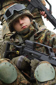 Portrait of young soldier with gun — Stock Photo