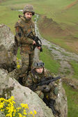 Soldiers in ammunitionon the cliff — Stock Photo