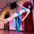 Stripper girl pole dancing in costume — Stock Photo