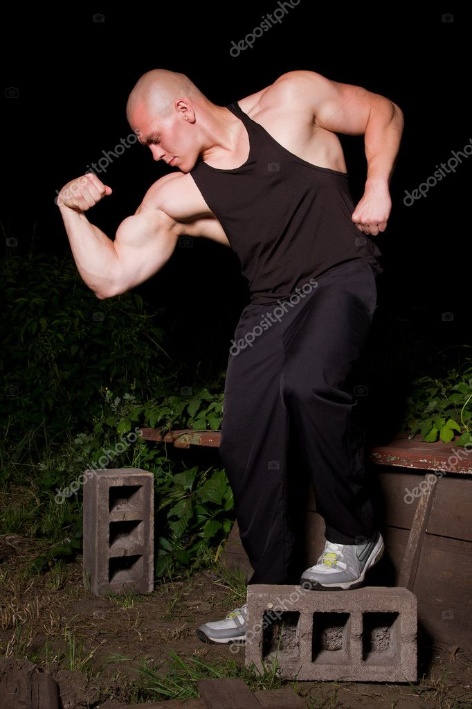 Pumped white guy posing in the backyard  Stock Photo #5833829