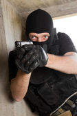 Soldier in black mask with 9mm pistol — Stock Photo