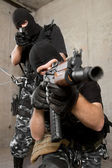 Soldiers in black masks with weapons — Stock Photo