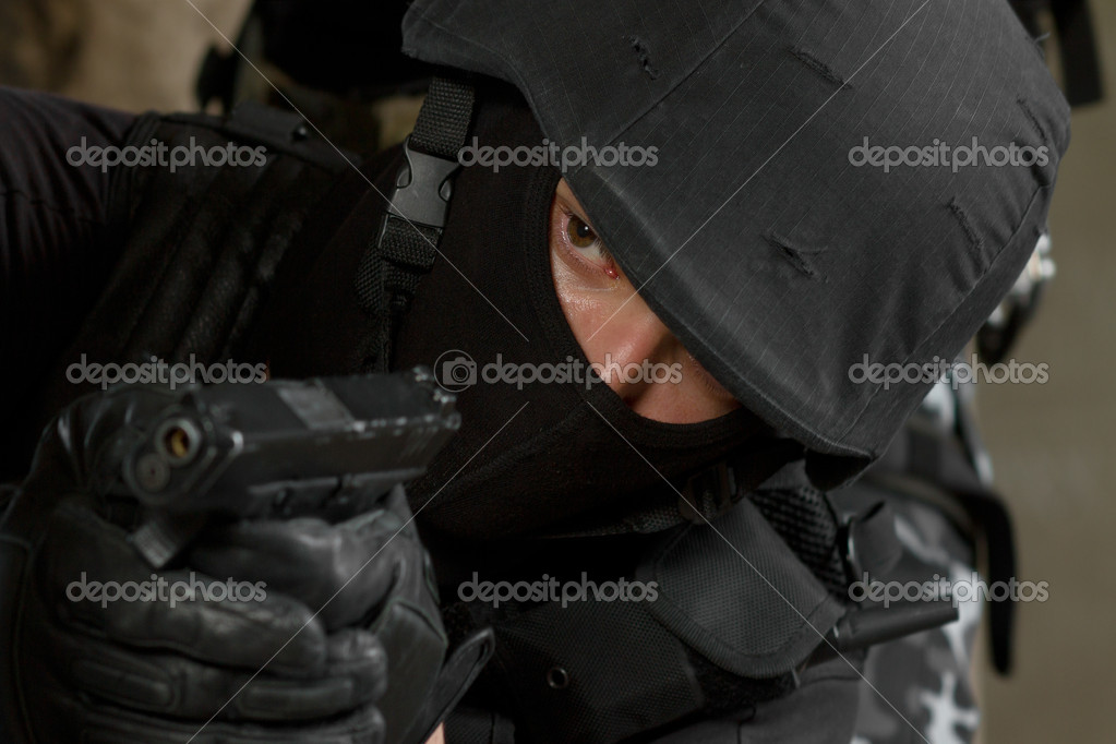 Photo of armed man in combat uniform playing terrorist or special forces team member  Stock Photo #5859660