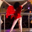 Stripper in red posing on stage — Stock Photo #5883728