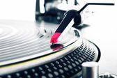 Turntable playing vinyl with music — Stock Photo