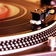 Turntable playing vinyl record — Stock Photo #5937330
