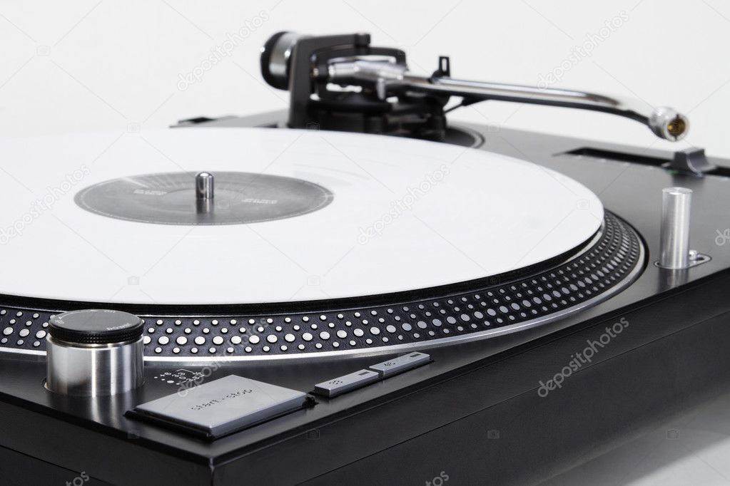 Professional DJ direct-drive turntable record player on white surface — Stock Photo #5931351