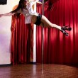 Stripper dancing on pole — Stock Photo #5987511
