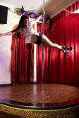 Stripper dancing on pole — Stock Photo