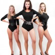 Group of three sexy ladies in black body suits on heels — Stock Photo #6438205