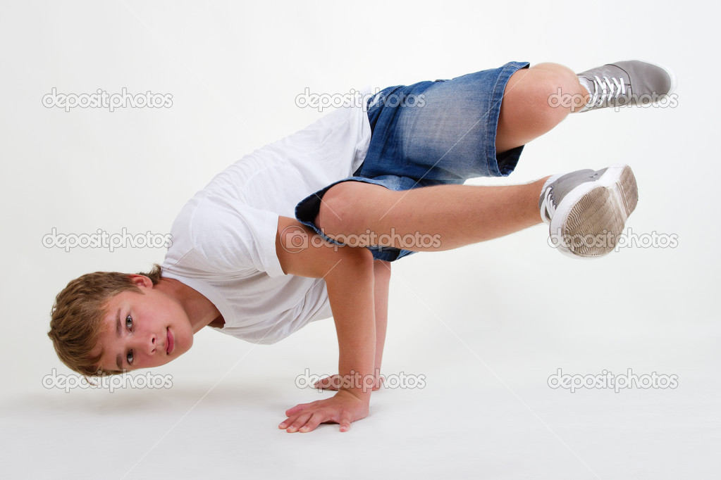 Teen b-boy standing in freeze on white © hurricanehank #6438146