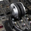 Dj headphones on mixer - Stock Photo