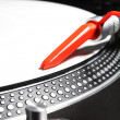 Turntable playing viyl record with music - Stock Photo