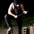 Gangster with baton outdoors at night — Stock Photo #6696085
