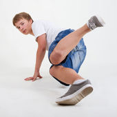 B-boy breakdancing on white — Stock Photo