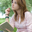 Teenager girl reading book — Stock Photo