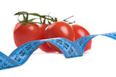 Tomatoes and measure tape — Stock Photo