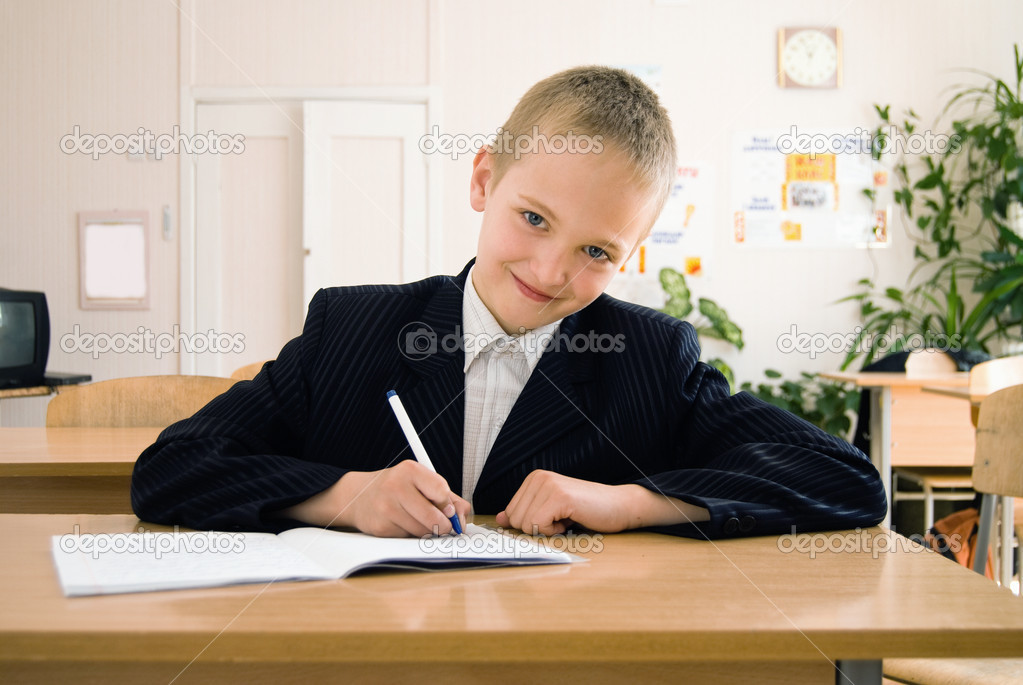 Schoolboy at the table in a classroom  — Stock Photo #5913852