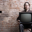 Mholding retro television — Stock Photo #6234077